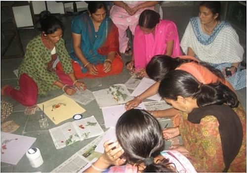 File covers and folders made from natural materials and embellished with dried flowers and leaves are quite a rage in the corporate world these days and it has worked out well for scores of rural women in Uttarakhand, who are able to earn a decent living making these products. (Credit: Nitin Jugran Bahuguna\WFS)