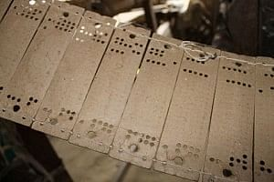 The rectangular cardboard with digital punched holes that somehow give rise to the patterns