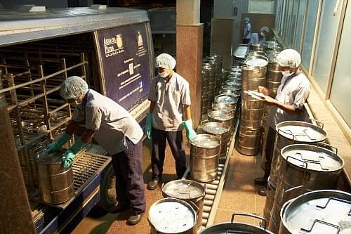 Food being loaded into delivery buses at Akshaya Patra