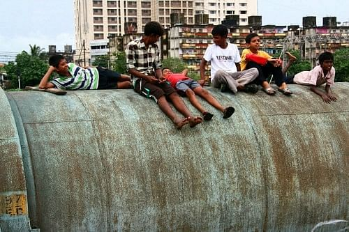 Kids relaxing near the pipeline – a place where they have lived and enjoyed