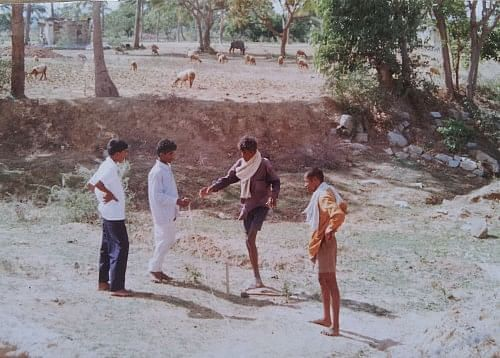 The villagers showing the lake bed which had been dry for many years.