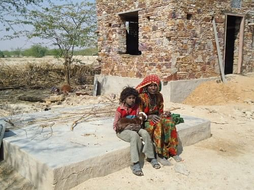 A bagariya mother with her child. Most of the children don't go to school.