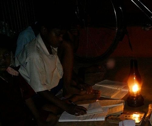 Child Studying using a Kerosene lamp