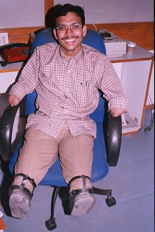 Raja is always smiling despite the fact that he lost all his limbs at the age of 5