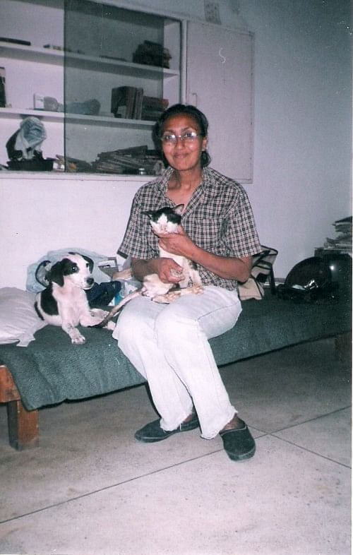Nita Seth, in her 60s, is caretaker for over 40 dogs and cats and all of them reside alongside her.