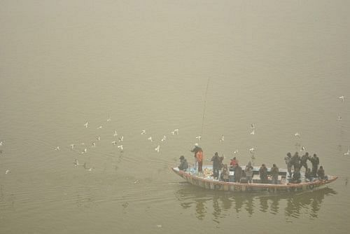 6:30 a.m in the morning, the waters are covered in dense fog. Sometimes, when the fog dissipates in parts, one can watch seagulls travelling with the boats, as the oarsmen throws fish food into the water.