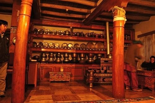 The Ladakhi Kitchen. The cooking area is on the floor to the right, embellished with motifs.