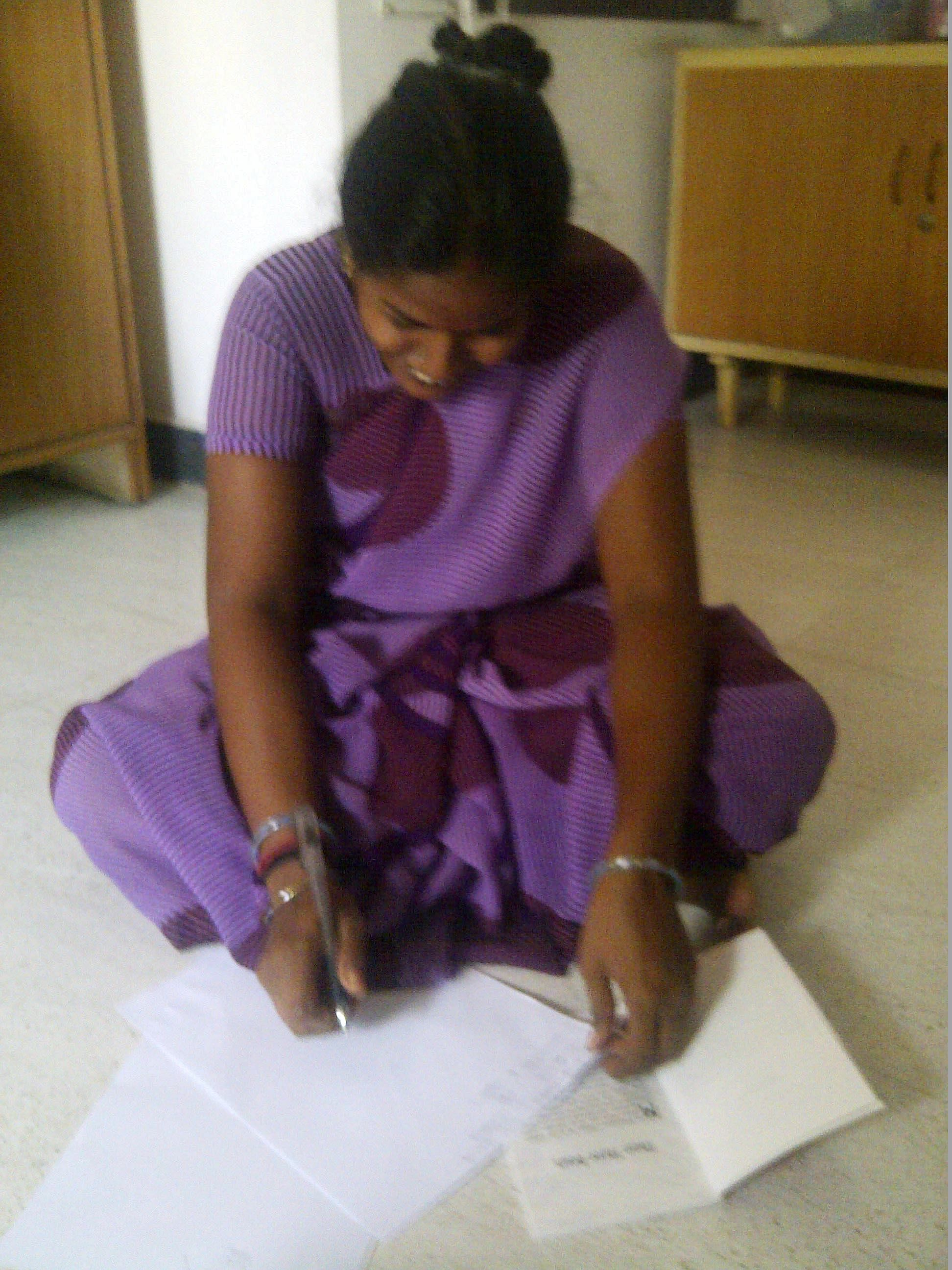 Education has always been Kani's dream. After Kani finishes with her work, Gita, her employer, sits down with her and they study together. (Credit: Kirthi Jayakumar\WFS)