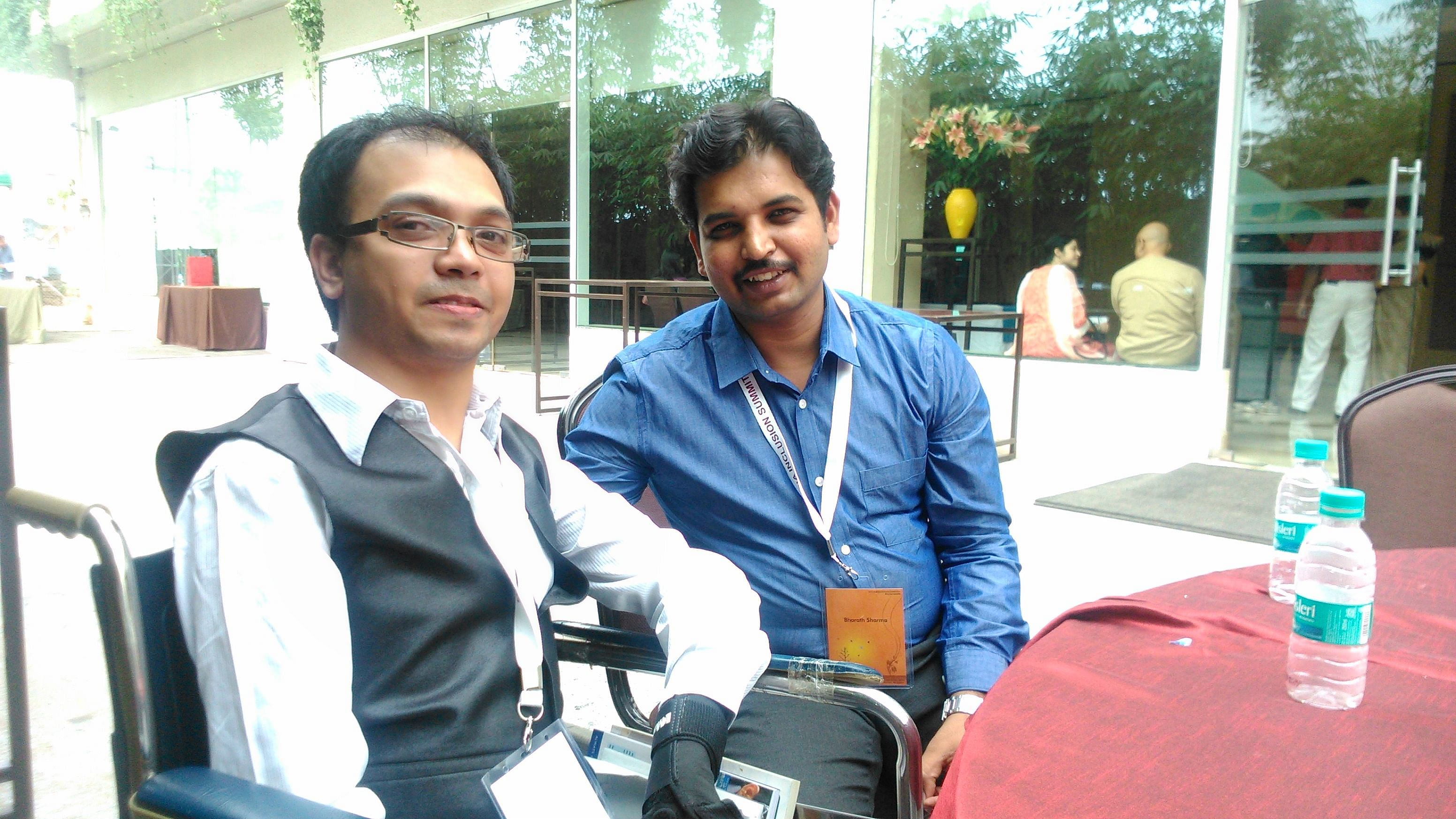Ashwin (left) with Bharath at India Inclusion Summit, Bangalore.