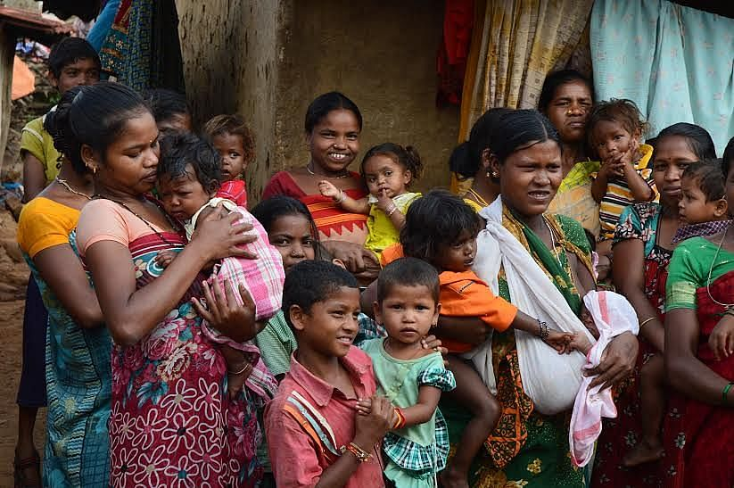 The content women of Champaguga, Andhra Pradesh, who have availed of the popular meal scheme that ensures a free nutritious meal daily for 25 days in a month to pregnant women and breastfeeding mothers. (Credit: Dilnaz Boga\WFS)