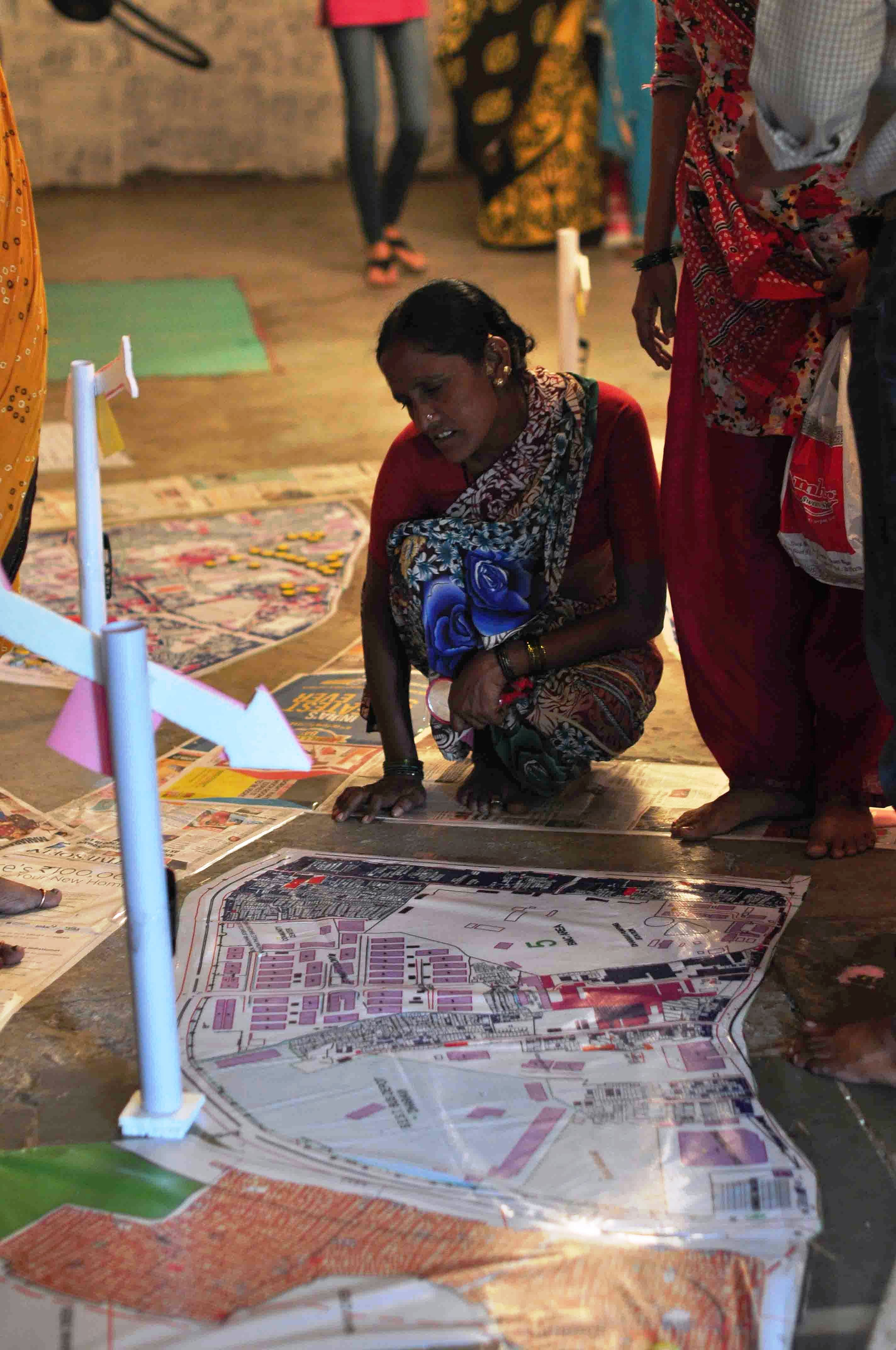 Women residents of Dharavi in Mumbai, with basic knowhow of embroidery stitched together 'Map the Hurt' with discarded denim that marks out areas in their sprawling slum where women often encounter abuse and violence. (Courtesy: SNEHA)