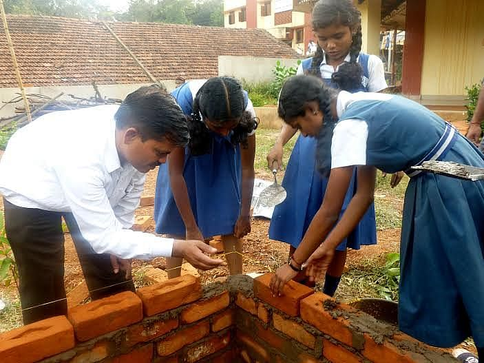 Students learning to lay bricks in construction training.