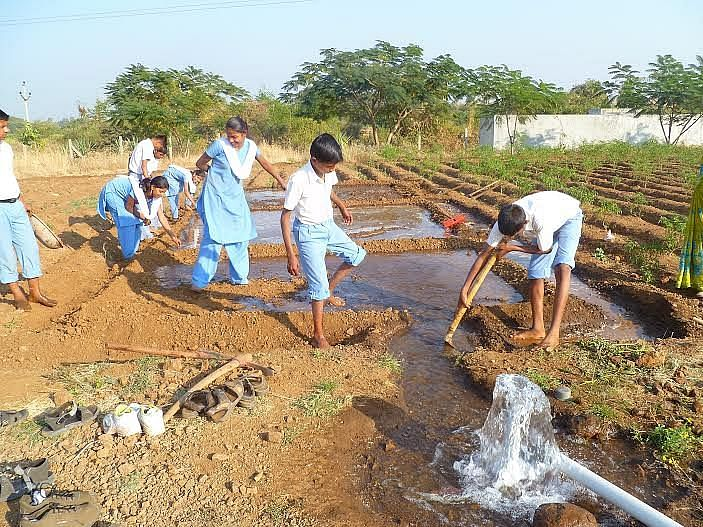 Students learning agriculture skills.
