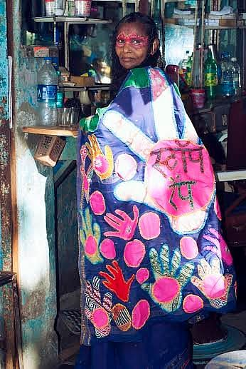Anjali Amma, 50, who can hardly read and write herself, proudly appliquéd the stark slogan, 'Stop Rape' on the pallu of the blue hand-me-down silk sari. (Courtesy SNEHA)