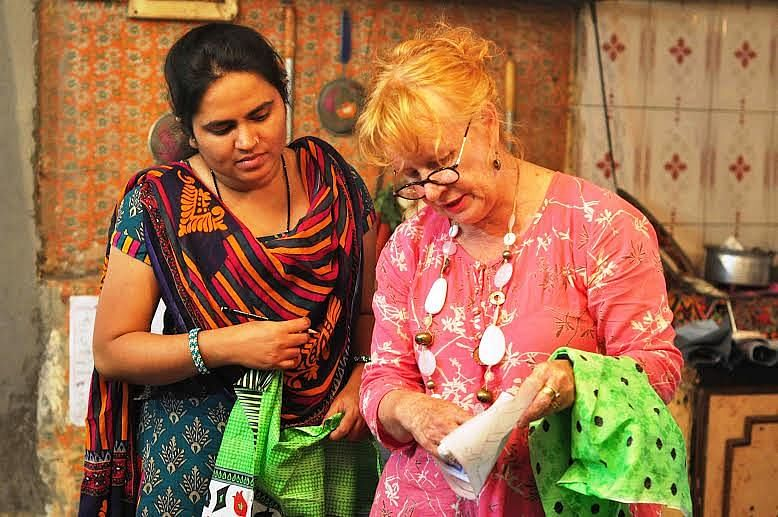 Susie Vickery, a textile artist, guided the women to create 'Map the Hurt', the saris with a message, and all other embroidery work on display. (Courtesy SNEHA)