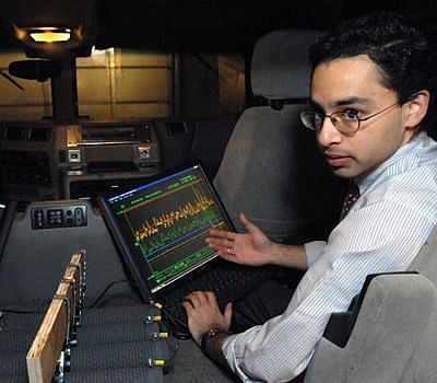 Shakeel Avadhany (Materials Science '09) monitors pressure, position, and generated power sensor data on the custom data acquisition system. Photo: Donna Coveney.