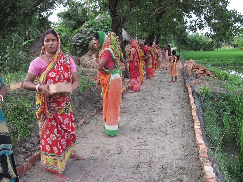 Parul Mondol, 45, who helped in the construction of the brick road, is happy that the villagers now have access to schooling, healthcare and many other government facilities. (Credit: Saadia Azim\WFS)
