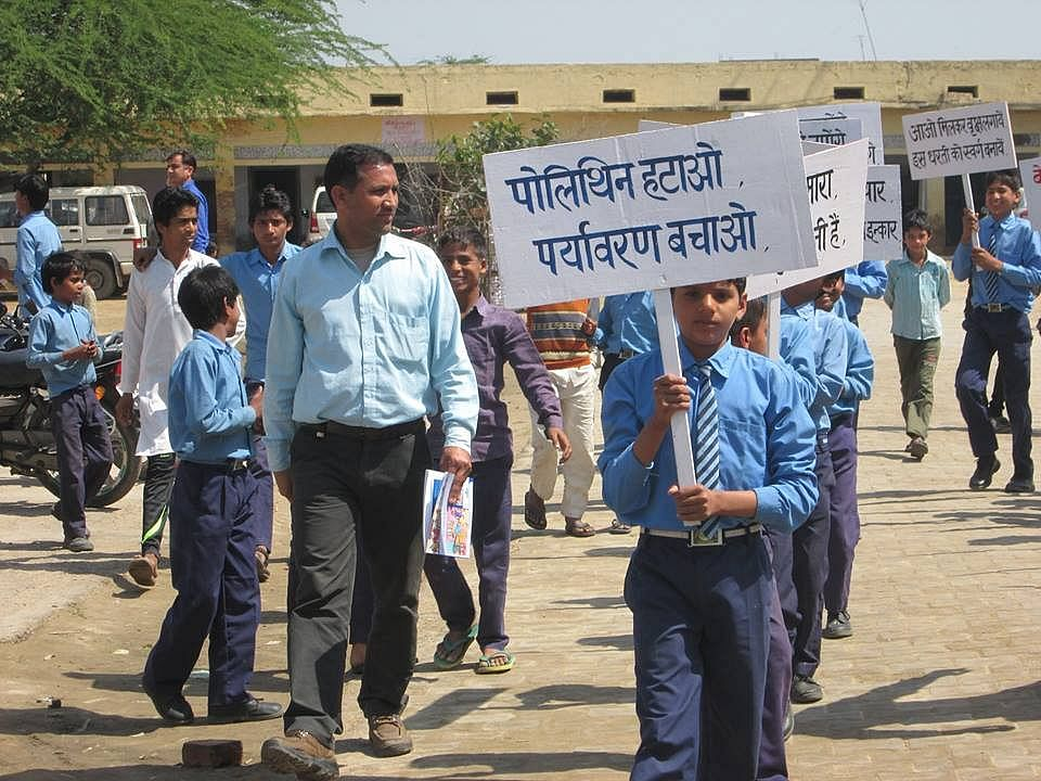 """Students holding placards """"Shun Polythene, Save Environment"""" in Mewat district"""