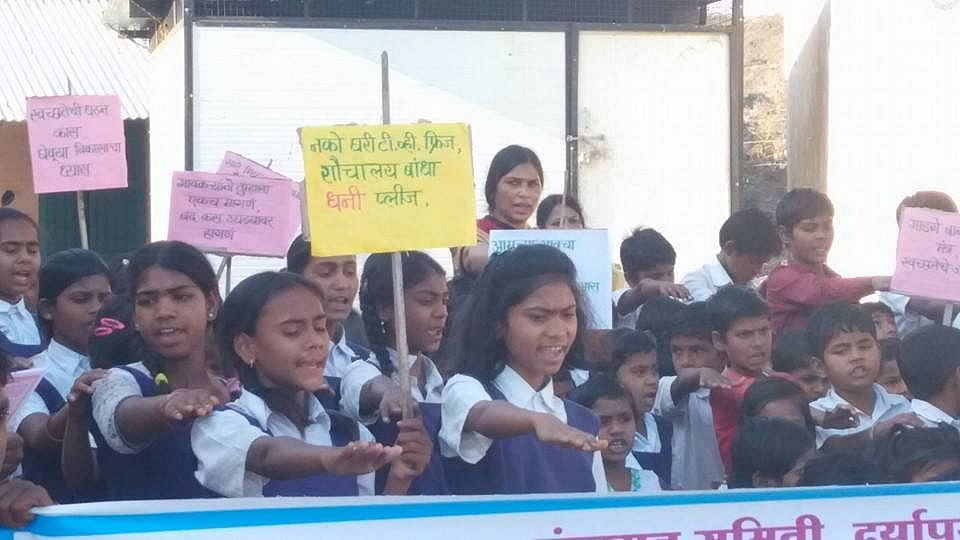 """Placard (translation) """"No TV & Fridge, first build Toilet please"""" in one of the many Vidyarthi rallies."""