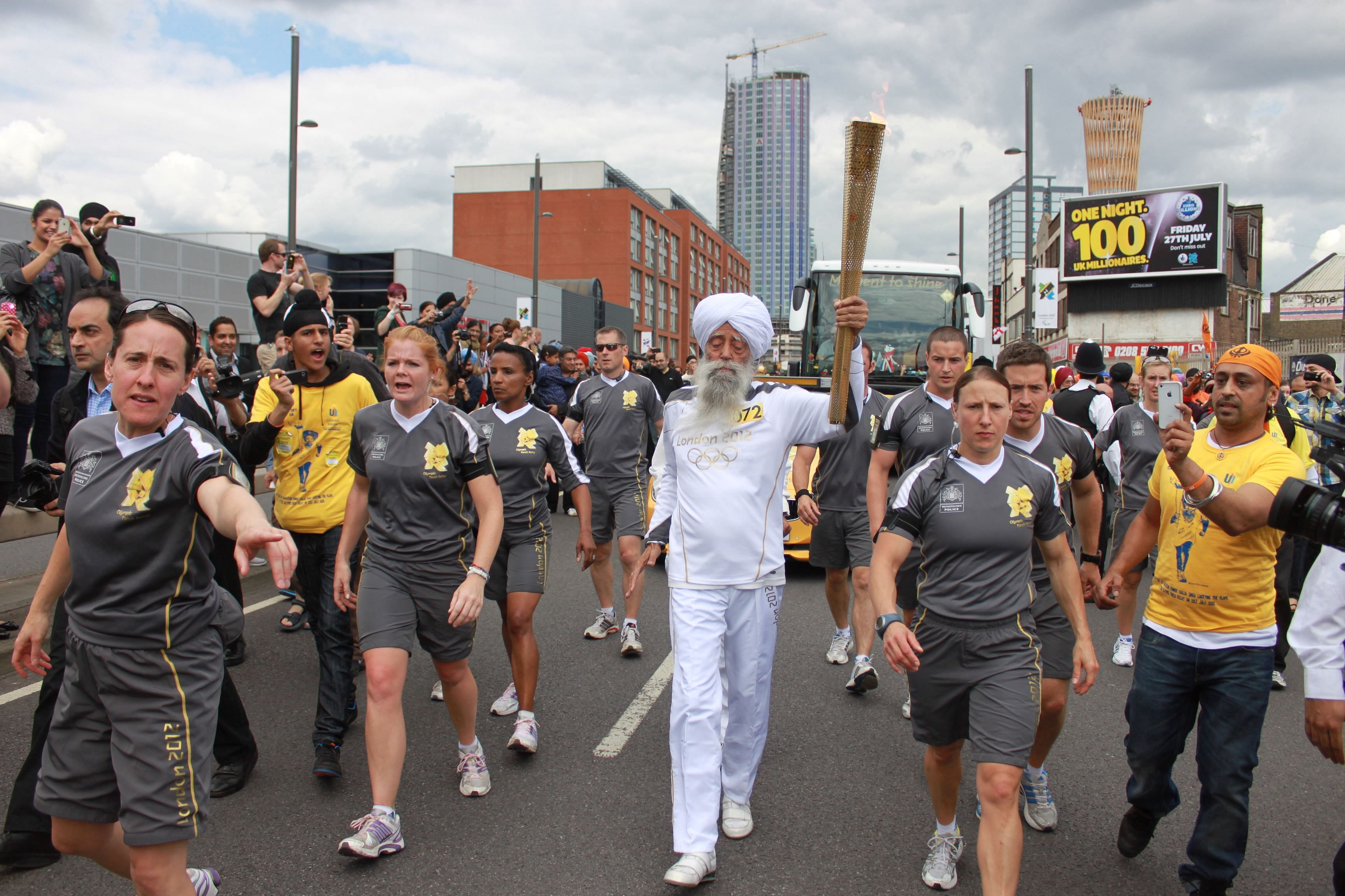 Fauja Singh running with the Olympic torch at the 2012 London Olympics
