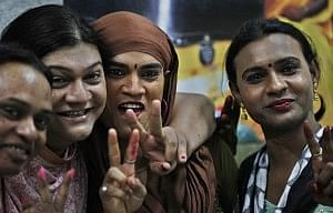 Images of transgender persons making victory sign