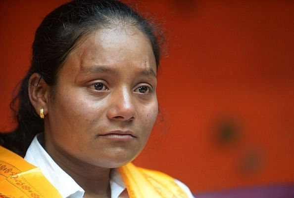 Indian mountaineer Arunima Sinha, who had her leg amputated below the left knee two years ago gestures during a press conference in Kathmandu on May 28, 2013. Twenty-six year old Sinha from the northern state of Uttar Pradesh, who lost her leg after she was thrown from a moving train two years ago, became the first female amputee to climb Everest on May 21. AFP PHOTO/ Prakash MATHEMA        (Photo credit should read PRAKASH MATHEMA/AFP/Getty Images)