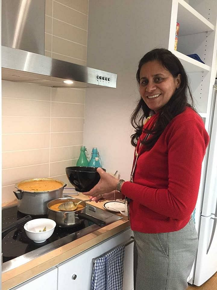 Nandita Bajaj cooking rice and curry at her work place
