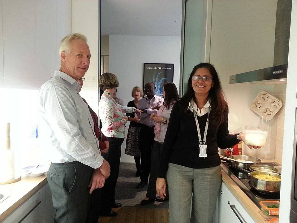 Nandita's office colleagues queuing up for her rice and curry lunch