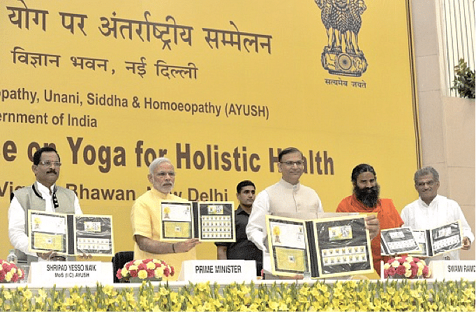 PRIME MINISTER NARENDRA MODI RELEASING THE FIRST DAY COVER, STAMP AND MINI SHEET ON INTERNATIONAL DAY OF YOGA AT THE VIGYAN BHAWAN ON 21 JUNE 2015