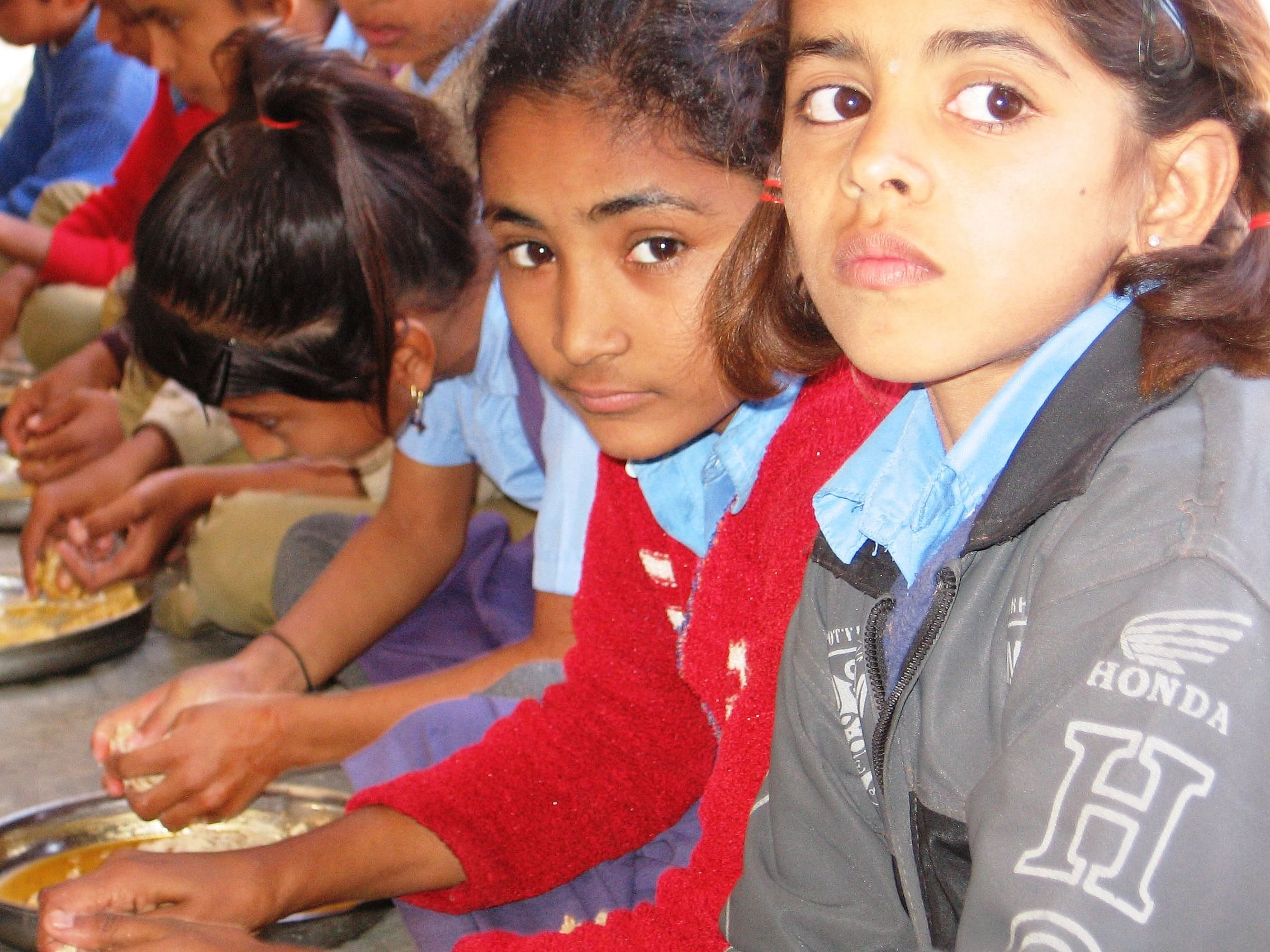 In Rajasthan, where child malnutrition is rampant, a special initiative is ensuring that these youngsters get their daily recommended quota of iron, folic acid and vitamins A and D through the mid day meals provided in state schools. (Credit: Abha Sharma/WFS)