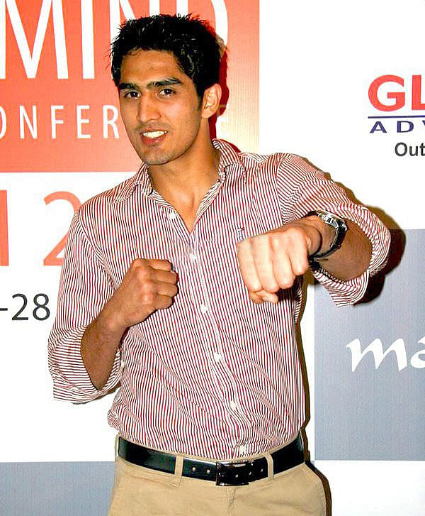 """""""Vijendersingh2"""" by IndiaFM - Vijender Singh strikes a pose at Milind Soman's party. Licensed under CC BY 3.0 via Wikimedia Commons"""