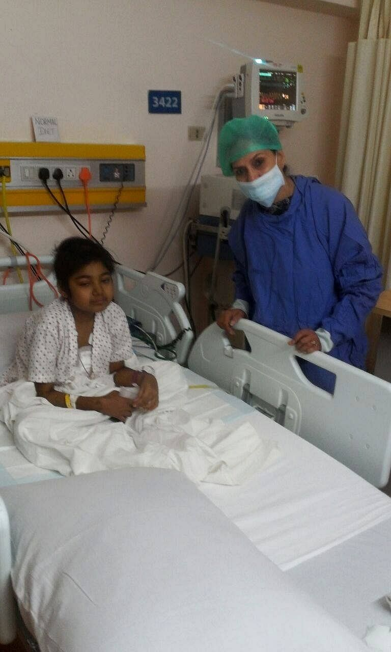 Paramjit taking care of Abeeha in the hospital