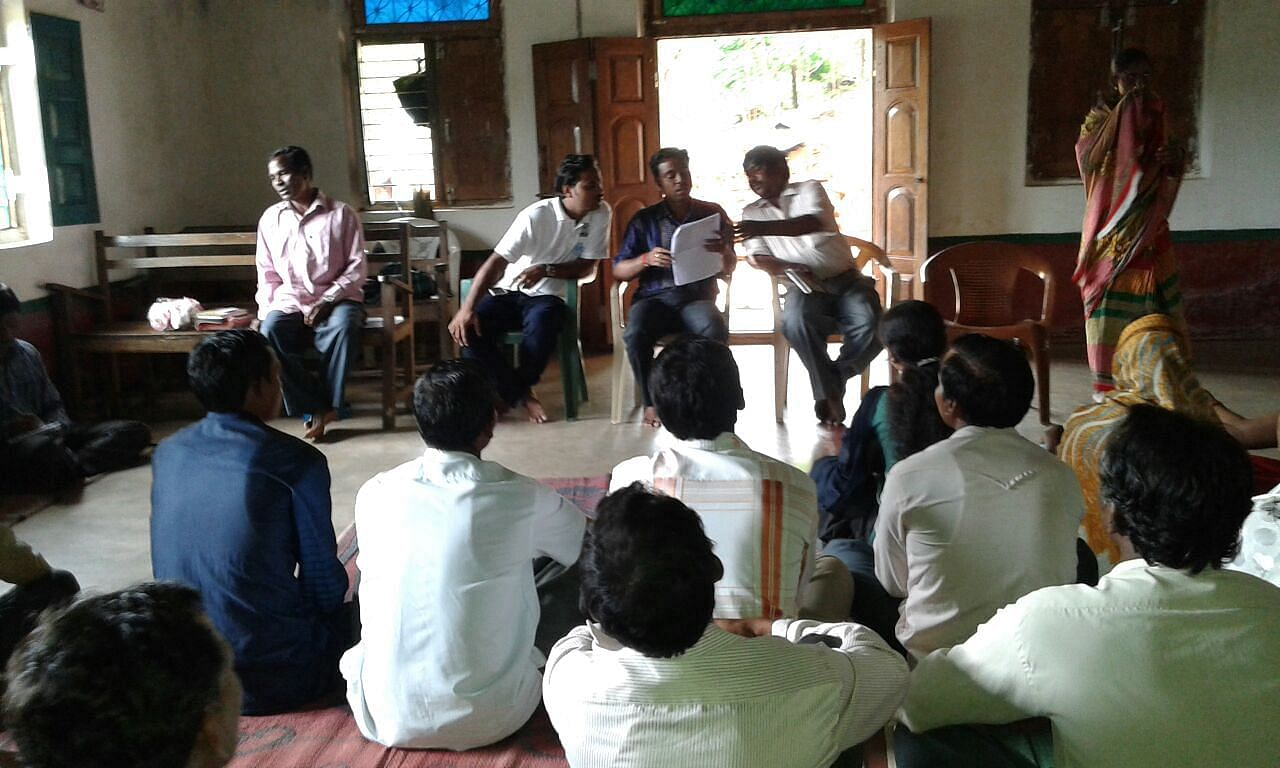 A meeting inside a church of Muri village of Luhangara panchayat, discussing how to include the left out beneficiaries in the campaign