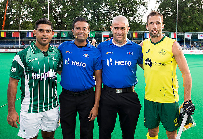 Indian Umpire Raghu Prasad (Second from Left) at the recent Fintro Hockey tournament.