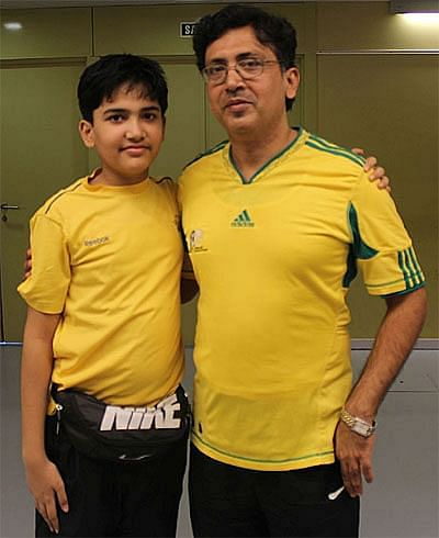 Aryan (left) with his father.