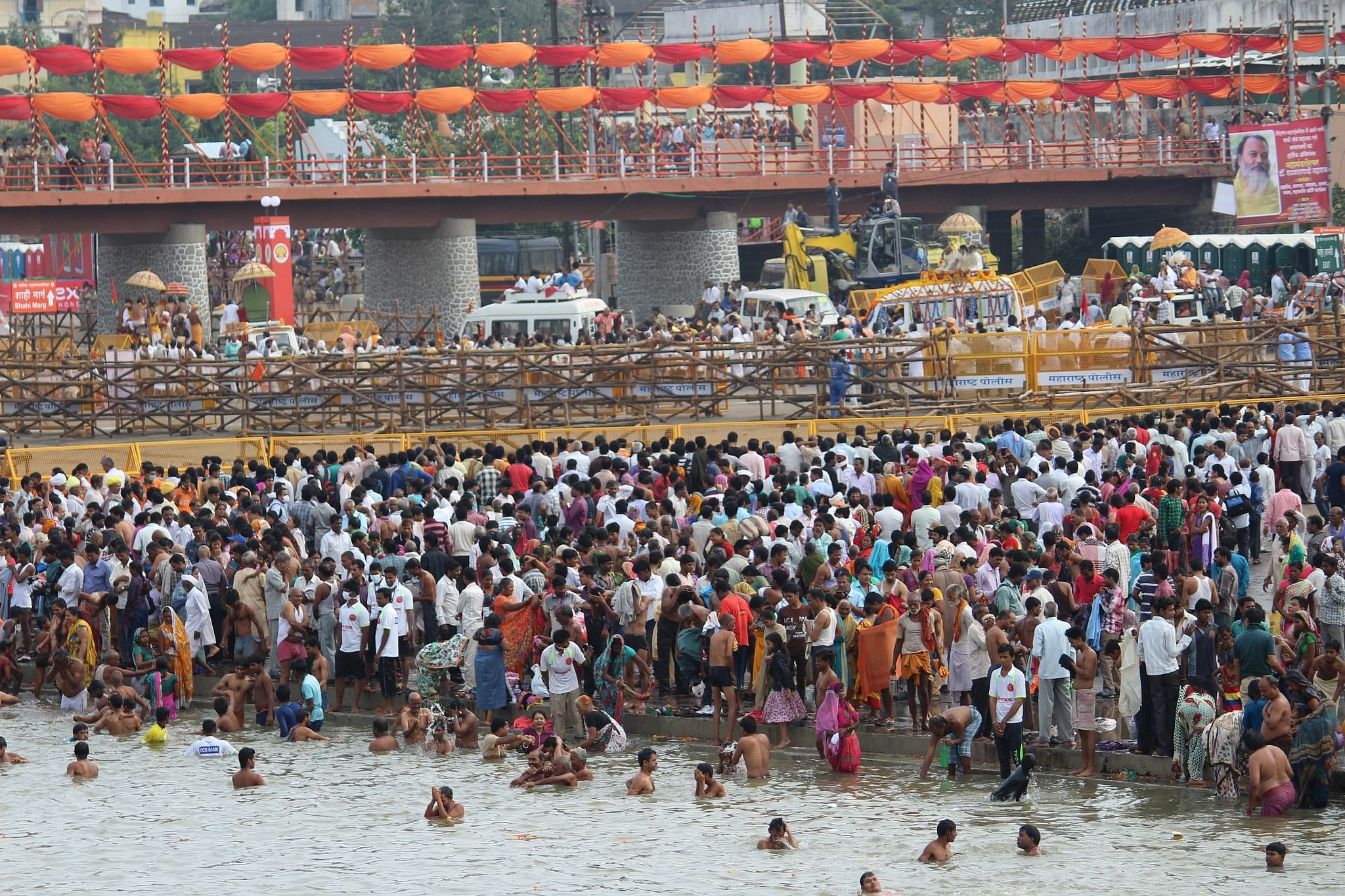 The shahi snan area and procession separated by barricades at Ramkund, Nashik