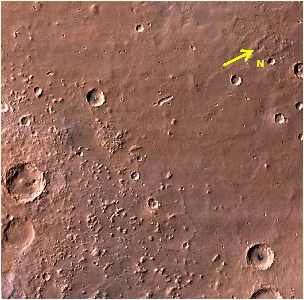 MCC image shows relatively smooth plains dotted with some craters and stepped mesas and knobs.