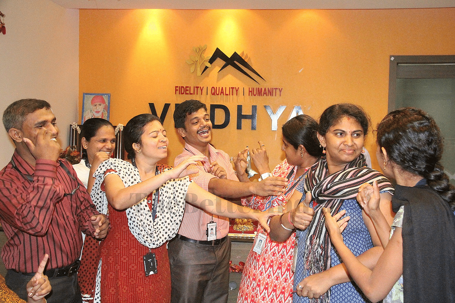 An informal sign language interaction between some of the employees in the Reception area of Vindhya E Infomedia