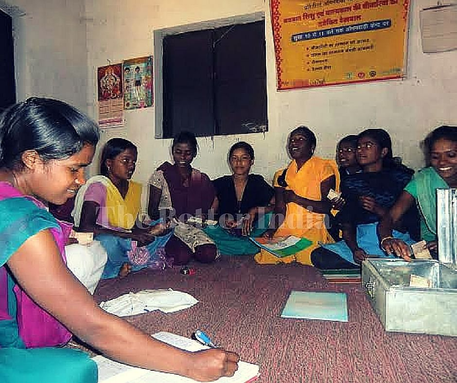 The girl gang of Jidu Pandra Toli Kishori Mandal takes a stock of their accounts as part of their micro-credit venture that allows them to take small loans as and when the need arises. (Credit: Ajitha Menon\WFS)