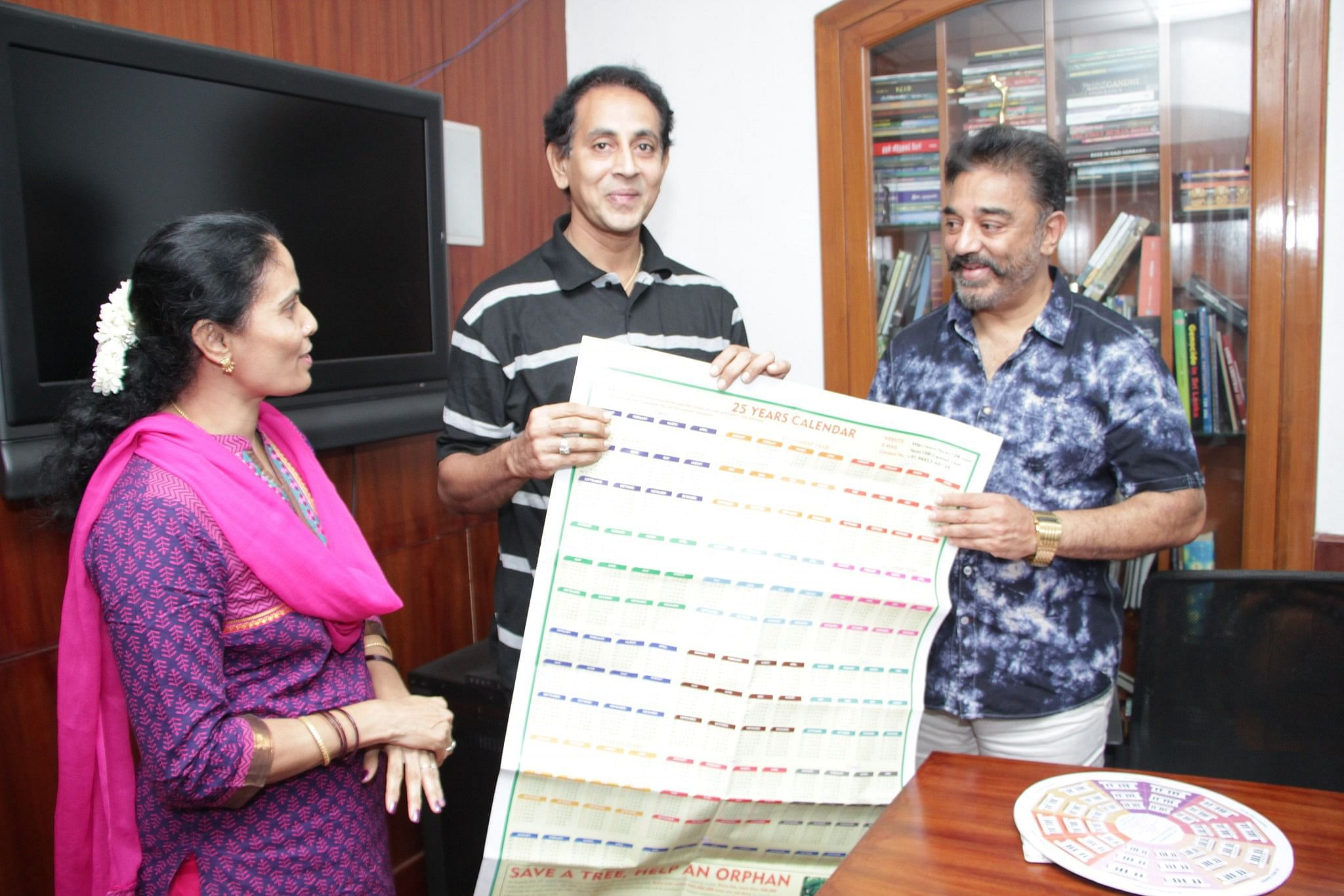 Ramesh and Sridevi showing the 25-year calender to Kamal Hassan