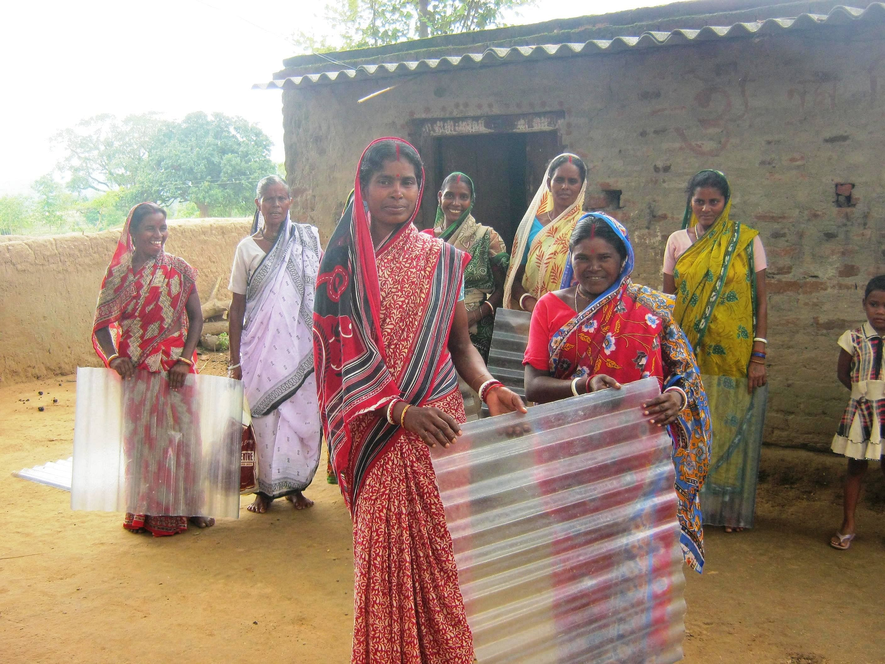 Thanks to bright natural sunlight that now filters into the once dingy kitchens of rural homes across Jhalda Block II women no longer are forced to cook on instinct randomly adding spices and even washing the vegetables, meat and fish very cursorily. (Credit: Ajitha Menon\WFS)
