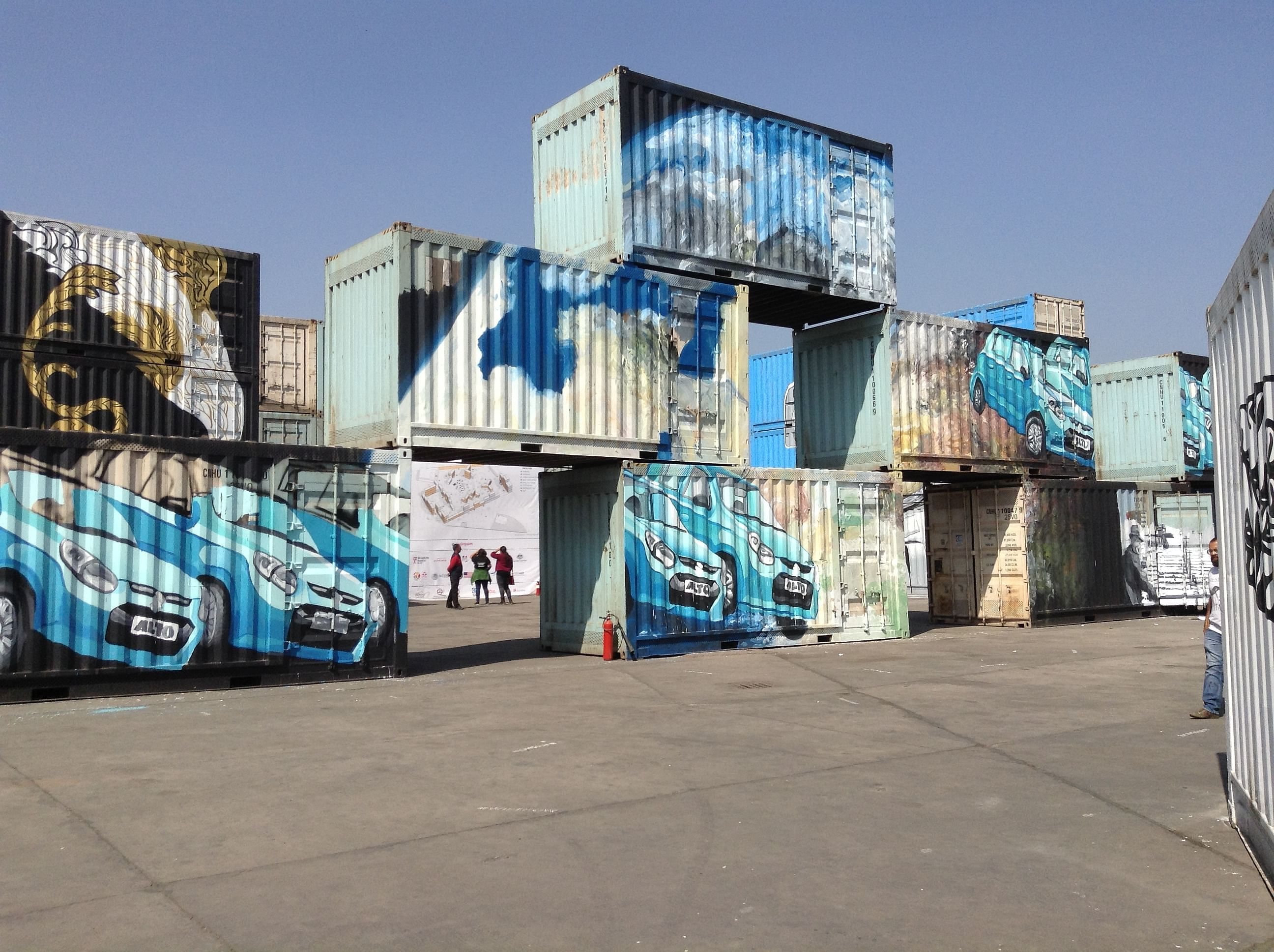 Alto's painted on a wall made of containers