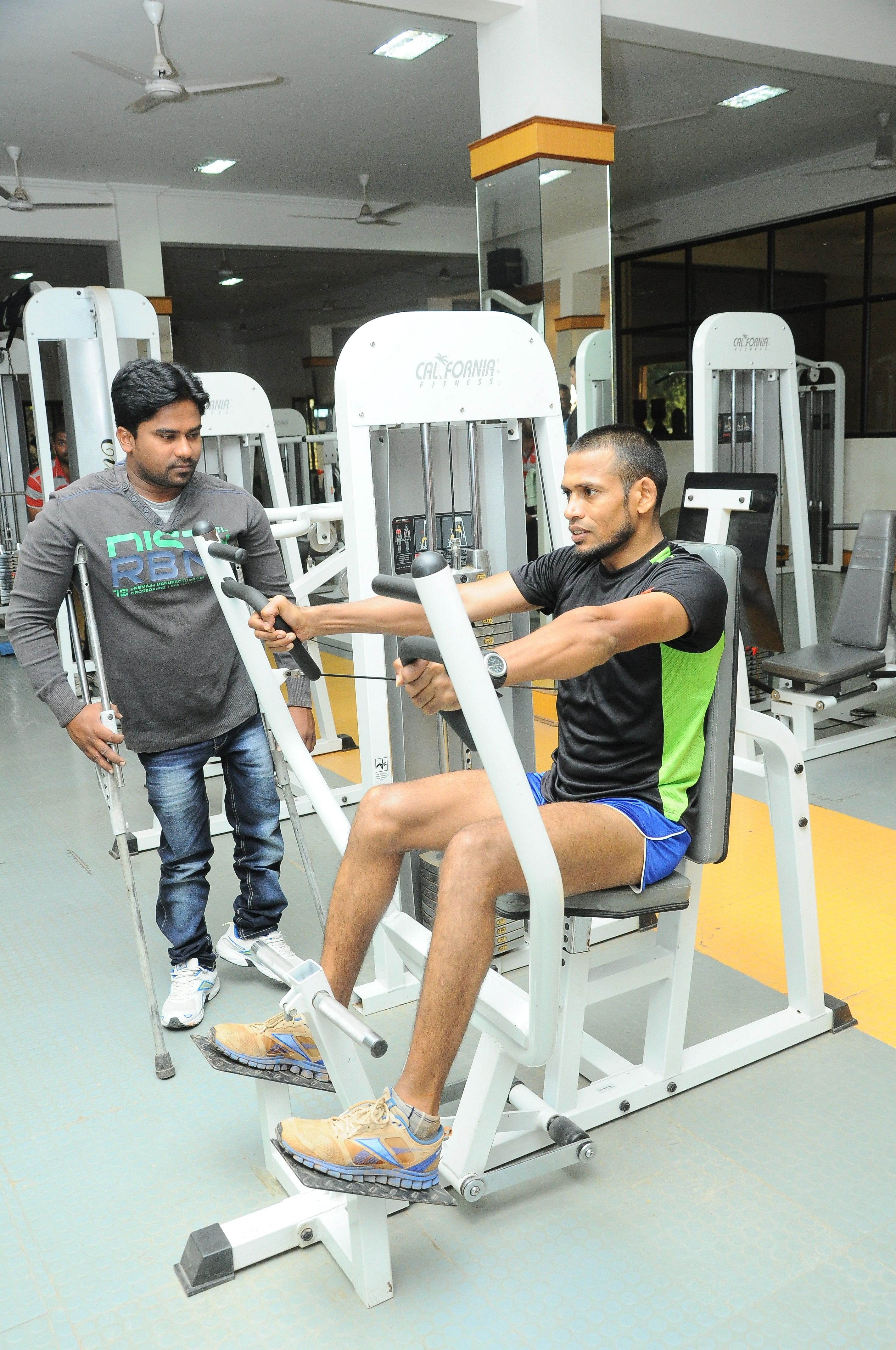 Kishore overseeing another of his pupil's training