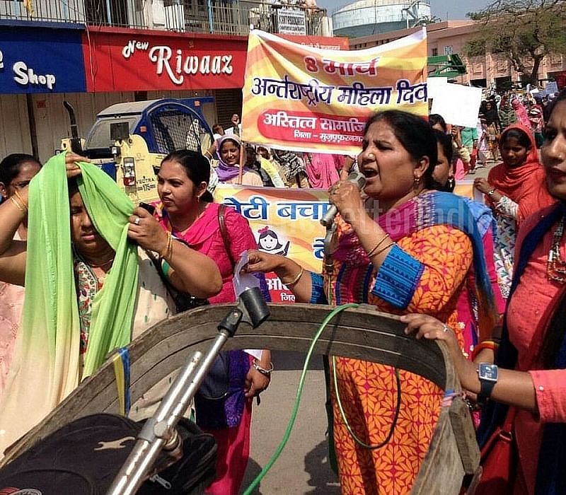 Addressing a rally on Women's Day