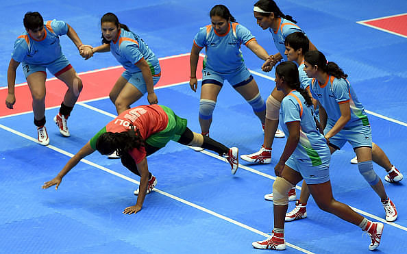 INCHEON, SOUTH KOREA - SEPTEMBER 28: Fatema Akhtar Poly of Bangladesh dives to evade India during the Kabaddi Womens Group Round match between India and Bangladesh during day nine of the 2014 Asian Games at Songdo Global University Gymnasium on September 28, 2014 in Incheon, South Korea. (Photo by Stanley Chou/Getty Images)