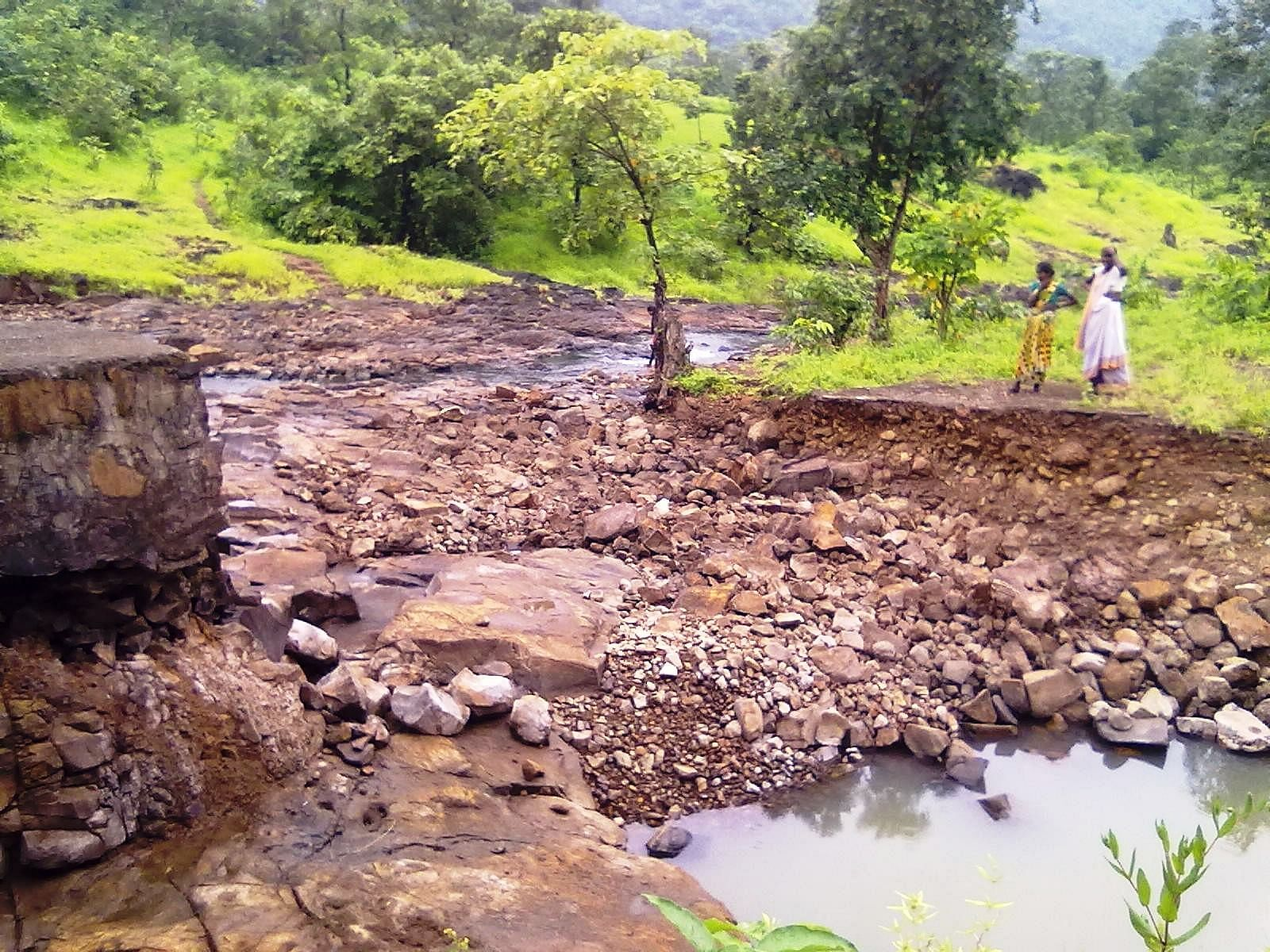 This is the broken pathway that the women of Pada Shendyachi Meth have to cross to access a small well that meets their water needs.