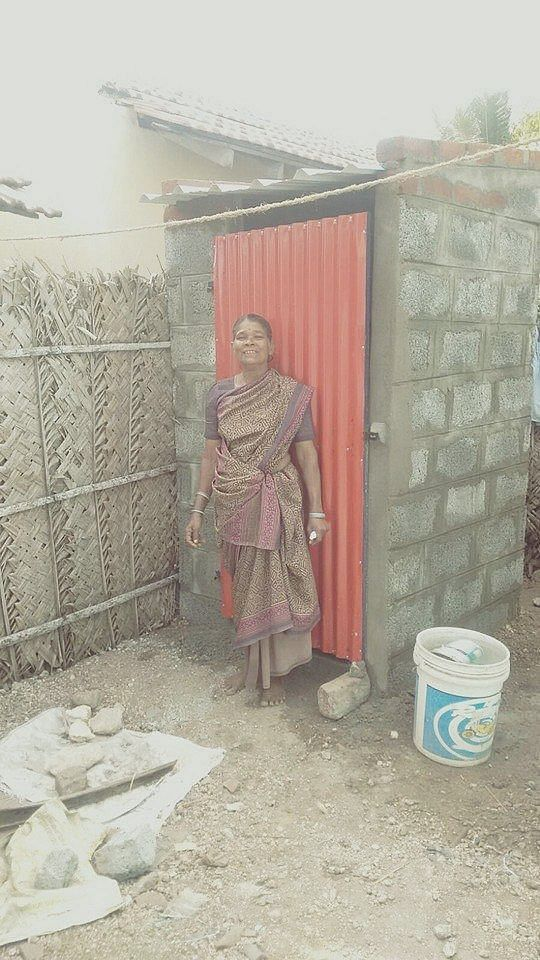 A happy beneficiary of the Toilet First initiative