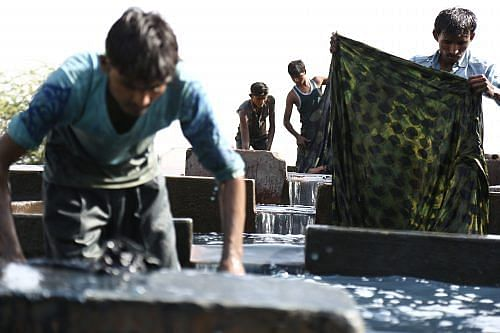 Dyeing of Ajrakh fabrics at Ajrakhpur - The Khatri community of Bhuj, are highly skilled in the process of dyeing and printing and have been masters of the craft since centuries