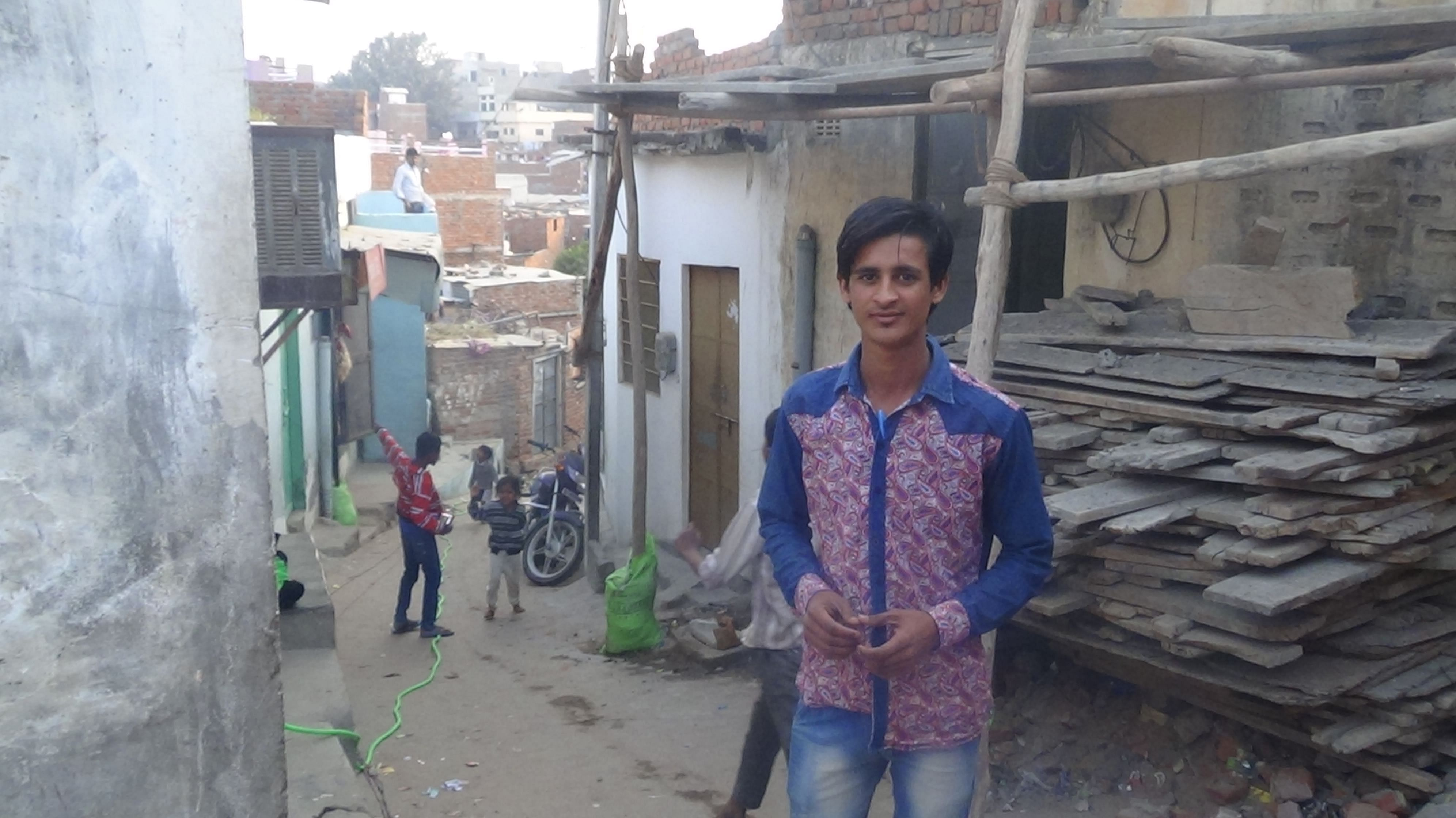 This is Mohsin and behind him is the Bhatta basti.