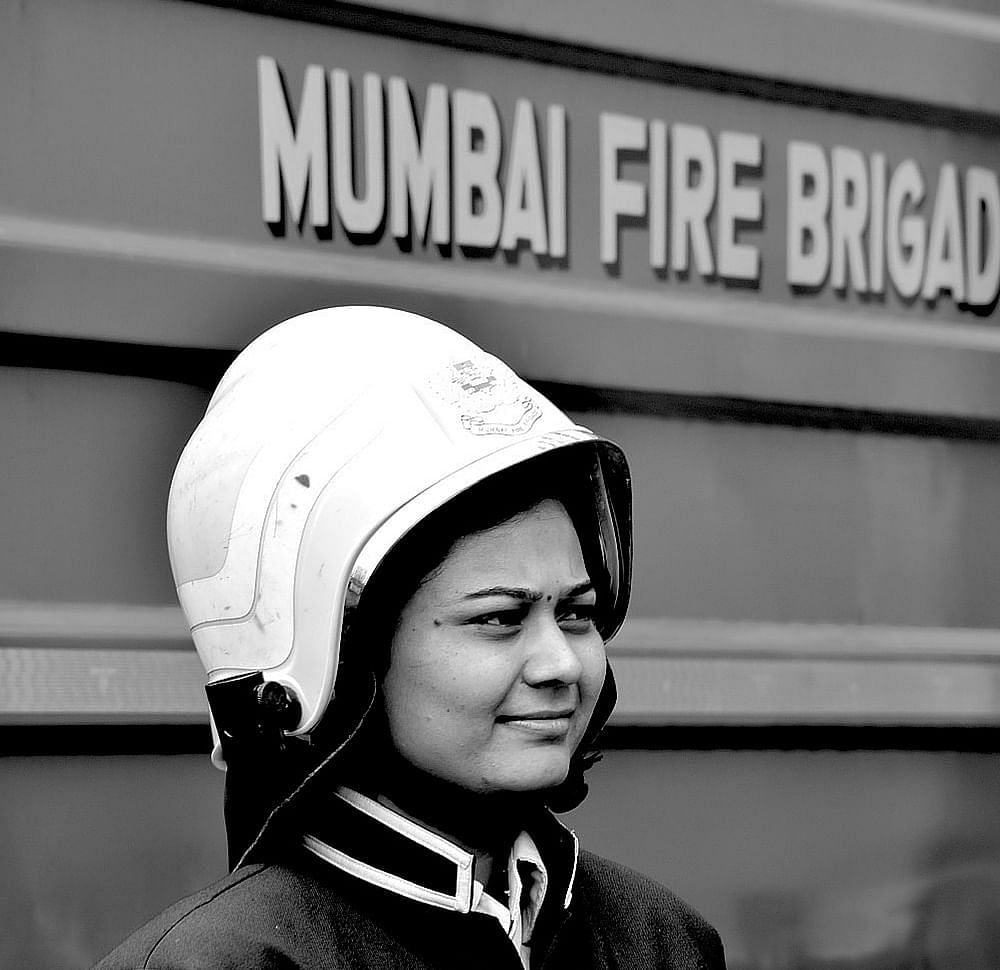 """Fire Fighter: The first question I asked her was """"do you have different duties because you are a woman"""" to which she promptly replied, """"In a uniform, there is no man or woman, we are saving lives and work as a team""""."""